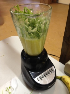 preparing a green smoothie