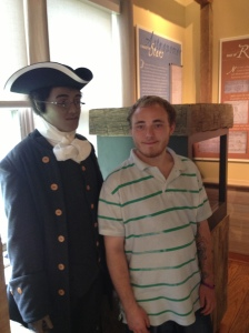 a student posing with Benjamin Banneker's statue