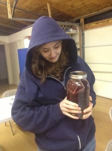 student holding tea