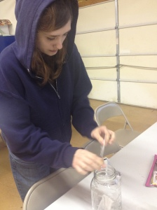 student preparing wild berry tea