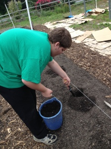 horticulture student digging holes in soil