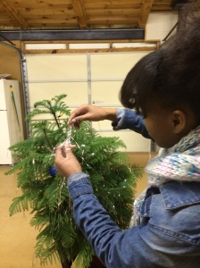 student decorating a christmas tree