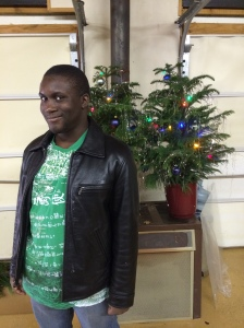 a student posing by the christmas tree